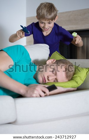 Father sleeping instead of taking care of his son - stock photo