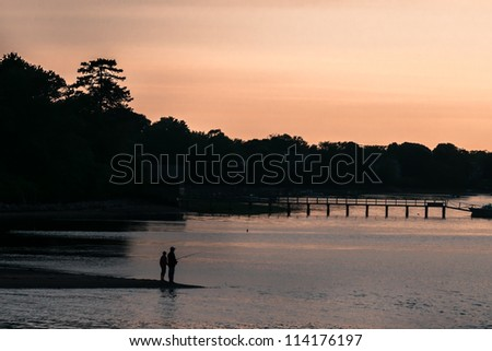 Father & son fishing silhouette - stock photo