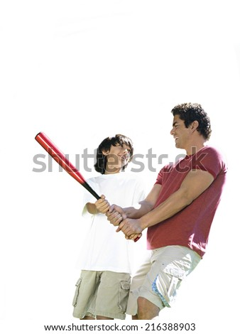 Father teaching son how to hold baseball bat, cut out - stock photo