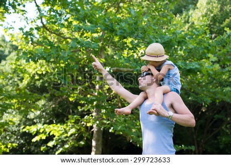 Father to piggyback daughter - stock photo