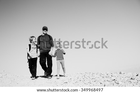 father traveling with two kids - stock photo