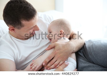 Father with adorable baby, close up - stock photo