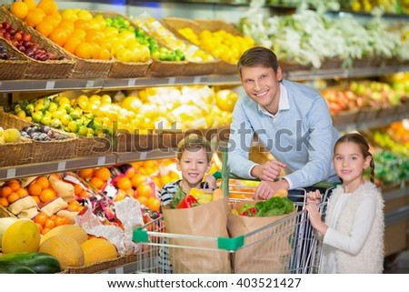 Father with children in a store - stock photo