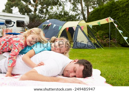 Father With Children Relaxing On Camping Holiday  - stock photo