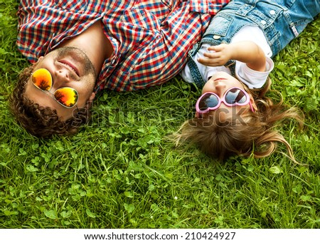 Father with daughter In Park smiling happy - stock photo