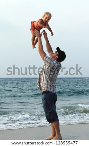 father with daughter on vacation at sea - stock photo