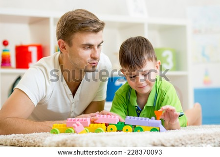 father with his child son playing together - stock photo
