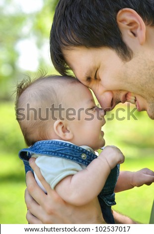 Father with his son. Focus on babies face - stock photo