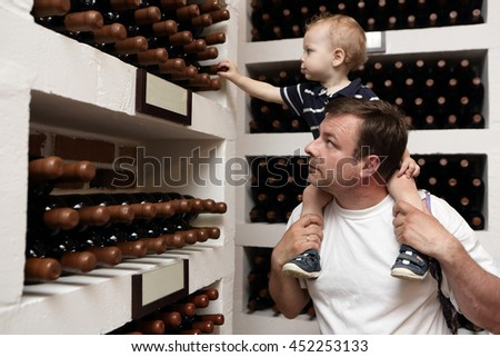 Father with his son have excursion at winery - stock photo
