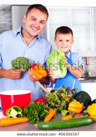 Father with his son in the kitchen making dinner.  - stock photo