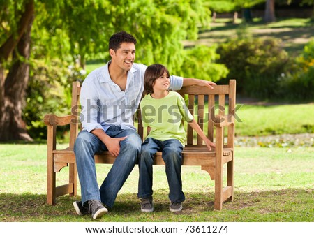 Father with his son on the bench - stock photo
