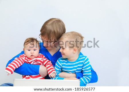 father with kids with laptop at home, family leisure - stock photo