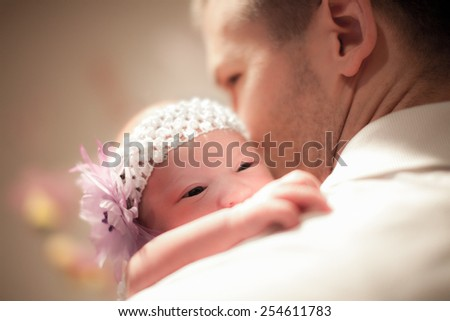 Father with Newborn - stock photo