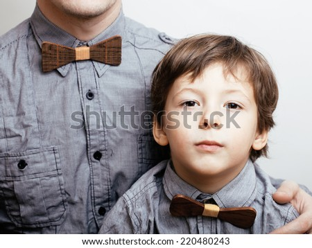father with son in bowties on white background, casual look family - stock photo