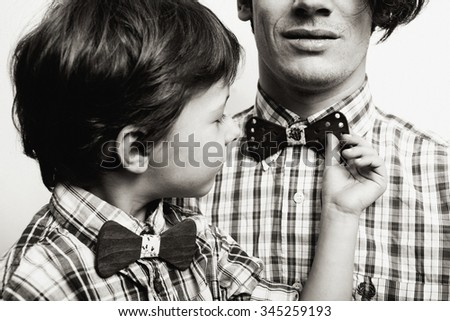 father with son in bowties on white background, casual look family close up hipster - stock photo