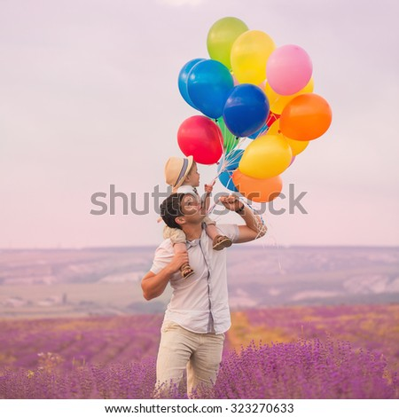 Father with son on lavender field - stock photo