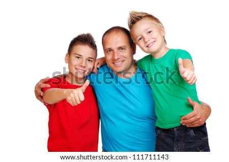 Father with two sons showing thumbs up - stock photo