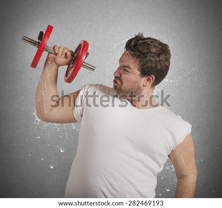 Fatigued fat man sweats while lifting weights - stock photo