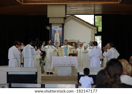 Fatima, Portugal - July 5, 2010: Ceremonial Mass at the Shrine of Fatima, Portugal, close to the Chapel of the Apparitions, with the presence of several priests and bishops - stock photo