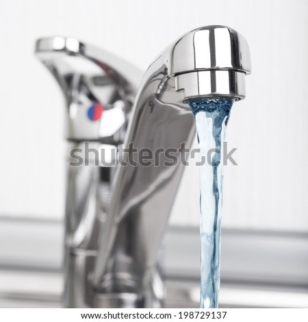 Faucet and water drop - stock photo