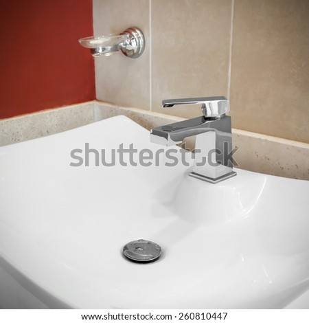 Faucet in bathroom, closeup - stock photo