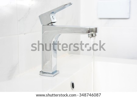 Faucet in the Restroom - stock photo