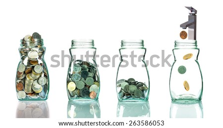 Faucet putting mix coins in clear bottle on white background,Business investment growth concept - stock photo