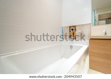 Faucet repair in the bathroom. Broken shower faucet. - stock photo