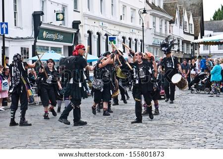 FAVERSHAM, UK-SEPTEMBER 1:  Morris dancers, Manic Morris dance during the parade at the  annual Hop Festival which celebrates the hop picking tradition in Kent. September 1, 2013 , Faversham,  UK. - stock photo