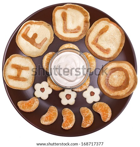 """Favorite Breakfast. Fritters with sour cream, pear flowers and tangerine """"Hello"""" - stock photo"""