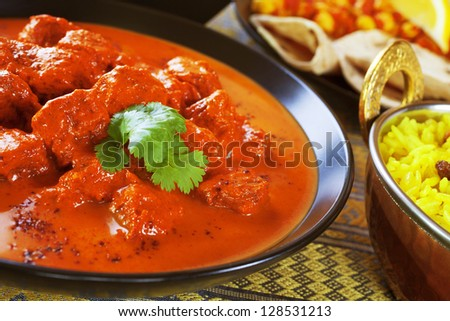 Favourite Indian curry Rogan Josh with pillau rice. - stock photo