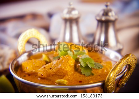 Favourite Indian meal, butter chicken with basmati rice, naan bread and lime. Holga lens, deliberately soft definition. - stock photo