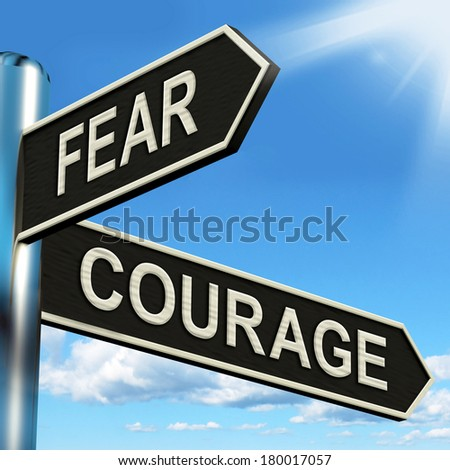 Fear Courage Signpost Showing Scared Or Courageous - stock photo