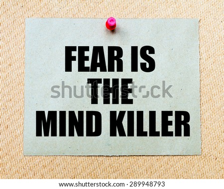 Fear Is The Mind Killer  written on paper note pinned with red thumbtack on wooden board. Motivation conceptual Image - stock photo