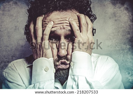 Fear, man in white shirt with funny expressions - stock photo