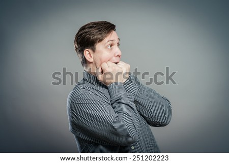 Fear, man is afraid in  shirt with funny expressions - stock photo