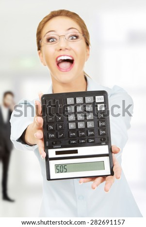 Fear woman with sos on calculator. - stock photo