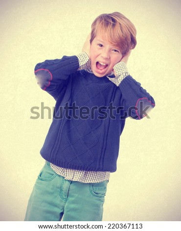 Fearful child screaming - stock photo