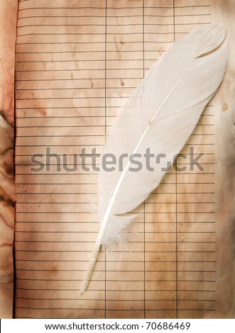 feather and old paper for a letter - stock photo