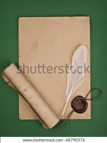 feather on a background of the empty form for the letter - stock photo