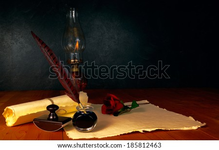 Feather pen and ink with kerosene lamp - stock photo