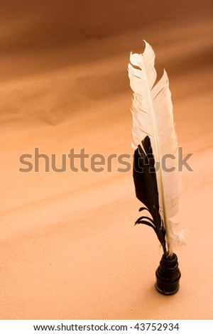 Feather quill and ink well - stock photo