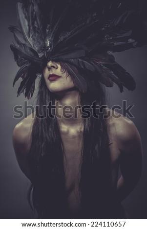 Feathers helmet, Sensual brunette woman in lingerie - stock photo