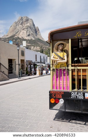 February 26,2016, Bernal, Mexico: tourist tour bus with the Bernal monolith in the background, the third largest monolyth in the world - stock photo