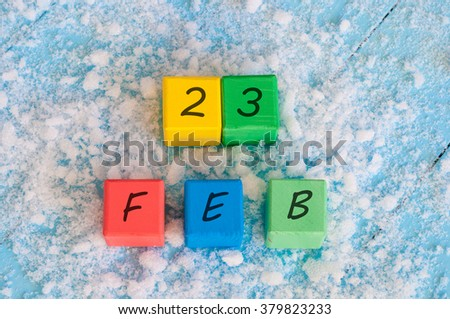 February 23rd. Calendar date on color wooden cubes with marked Date 23 of february. Winter end concept, leap year - stock photo