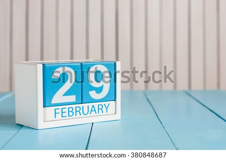 February 29th. Cube calendar for February 29 on wooden surface with empty space For text. Leap year, intercalary day - stock photo