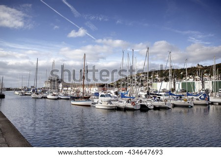 FECAMP, FRANCE - SEPTEMBER 30, 2012: Town and Ships in Port at Fecamp Normandy France - stock photo