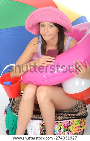 Fed Up Bored Young Woman in her Twenties on Holiday Holding Her Passport Looking Sad - stock photo