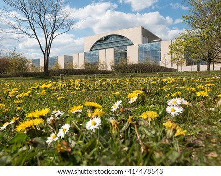 Federal Chancellery with flower meadow in Berlin Germany - stock photo