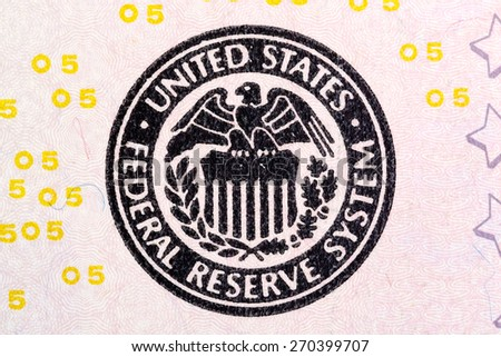 Federal Reserve System sign on five U.S. dollar bill. - stock photo